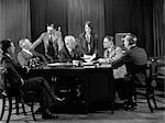 1930s RETRO MEN WOMAN MEETING BUSINESS DESK