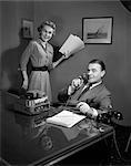 1950s MAN WOMAN MEETING BOSS SECRETARY TELEPHONE DICTATION MACHINE PAPERWORK