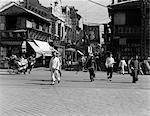 1920s 1930s TYPICAL STREET SCENE IN SHANGHAI CHINA PEDESTRIANS PEOPLE SHOPS RICKSHAW DAYTIME