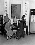1920s 1930s TWO CHINESE MEN SAMPLING TEA IN HOUSE OF WANG TEA SHOP IN HANGCHOW CHINA