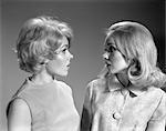 1960s TWO BLOND WOMEN IN PROFILE TALKING