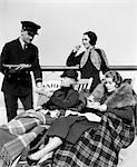 1930s THREE WOMEN BEING SERVED TEA BY A STEWARD ON BOARD AN OCEAN LINER CROSSING THE ATLANTIC OCEAN