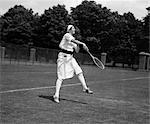 1920s WOMAN PLAYING TENNIS