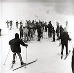 1960s WINTER SKIING GROUP MEN WOMEN CHILDREN SNOW WINTER SPORTS