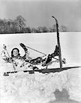 1930s WOMAN SKIER FALLEN IN SNOW