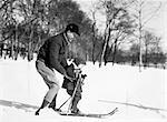 1930ER JAHRE JACKE VATER-SOHN-VATER TRAGEN HUT SOHN TRAGEN SNOWSUIT VATER LEHRE SOHN AUF SKI