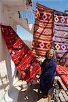 Woman weaver selling her blankets in village near Lasithi Plateau, Crete, Greek Islands, Greece, Europe