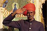Guard in turban saluting at City Palace, Jaipur, Rajasthan state, India, Asia