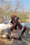 Man smoking drugs, near Deogarh, Rajasthan state, India, Asia
