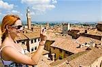 Woman Taking Photograph, Siena, Siena Province, Tuscany, Italy