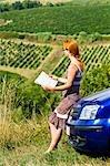 Lost Woman Reading Road Map, Chianti, Tuscany, Italy
