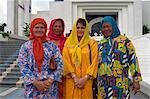 Four women in traditional Muslim Malay dress, Kuala Lumpur, Malaysia, Southeast Asia, Asia