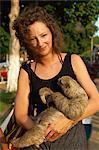 Lady cuddles three toed sloth, Alter do Chao, Amazon area, Brazil, South America