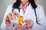 Doctor Holding Bottle of Pills
