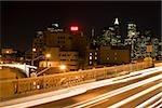 Expressway on the Brooklyn Bridge and Manhattan skyline at night, New York City