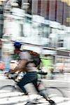 A cyclist on a city street, Manhattan, New York City