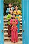 Balinese girls smiling at camera