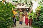 Balinese girls throwing flowers