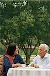 senior couple having coffee outdoors