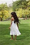 Little girl in park wearing white