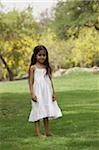 Little girl standing in park