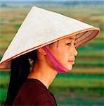 Vietnam, Chua Huong Province, young Vietnamese girl wearing conical hat