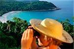 Malaysia, Terengganu State, Pulau Perhintian, Long Beach, tourist holding binoculars