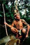 Malaysia, Sarawak, Sri Aman Division, Iban man sitting in small boat