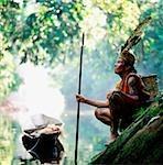 Malaysia, Sarawak, Sri Aman Division, Engkilili, Iban Shaman wearing traditional dress at riverside