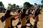 Indonesia, Lombok, Muslim girls marching in school.