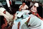 Malaysia, Kuala Lumpur, Muslim men and women study together at the International Islamic University.