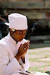 Indonesia, Bali, Hindu priest praying.