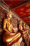 Thailand, Bangkok, Wat Suthat, Row of Buddhas.