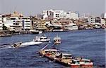 Thailand, Bangkok, Barges on river.