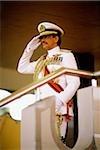 Brunei, Sultan Hassanal Bolkiah saluting during military ceremony in honor of his birthday.