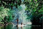 Malaysia, Sarawak, Iban men on boat
