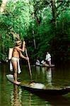 Malaysia, Sarawak, Iban man in small boat