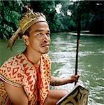 Malaysia, Sarawak, Iban warrior in traditional costume