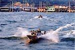 Brunei, fast water taxies shuttle between Kampong Ayer and Bandar Seri Begawan.