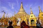 Myanmar (Burma), Yangon (Rangoon), Monks in front of Shwedagon Pagoda.