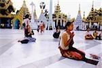 Myanmar (Burma), Yangon (Rangoon), People praying at the Shwedagon Pagoda.