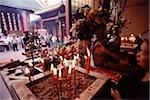 Malaysia, Kuala Lumpur, Chinatown, Man praying at Chinese Temple.