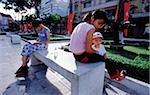 Vietnam, Ho Chi Minh ville (Saigon), vietnamien reposant sur la place de fils de Lam.