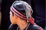 Vietnam, Sa Pa, Close-up of Hmong boy wearing traditional cap
