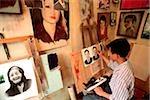 Vietnam, Hanoi, man painting in studio