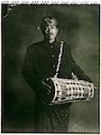 Indonesia, Bali, Amlapura, Gamelan player holding drum.