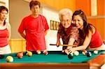 Three generation family, playing billiards
