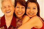 Three generations of women, looking at camera, smiling