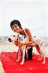 Woman with Dalmatian on beach