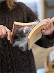 Woman Hand Carding Sheep's Fleece